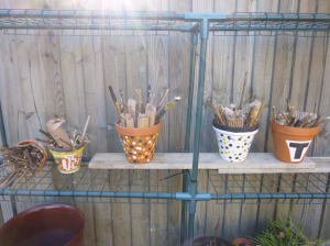Bug hotels made from terracotta pots, painted and filled by the service users. This is one way of encouraging insect predators to make a home in the garden.