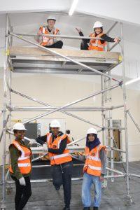 Volunteers refurbishing a community hall